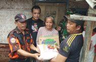 Pemuda Pancasila Distribusikan Bantuan Sembako untuk Korban Banjir